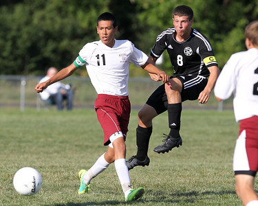 Mike Greene - mgreene@shawmedia.com Marengo's Alexia Noriega (left) and Kaneland's  Alex Gil watch a ball hit by Gil during a game Tuesday, August 21, 2012 at Marengo High School. Kaneland defeated Marengo 4-1.