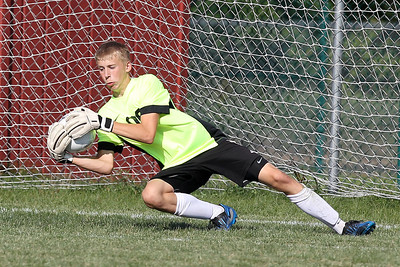 Mike Greene - mgreene@shawmedia.com Marengo's Dylan Marks blocks a shot during a game against Kaneland Tuesday, August 21, 2012 at Marengo High School. Kaneland defeated Marengo 4-1.