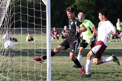 Mike Greene - mgreene@shawmedia.com Kaneland's Anthony Parillo kicks a shot into the back of the net while being defended by Marengo's during a game Tuesday, August 21, 2012 at Marengo High School.Mike Greene - mgreene@shawmedia.com Kaneland's Anthony Parillo kicks a shot into the back of the net while being defended by Marengo's Jordan Herrara during a game Tuesday, August 21, 2012 at Marengo High School. The goal was Parillo's third of the game and helped Kaneland defeat Marengo 4-1.
