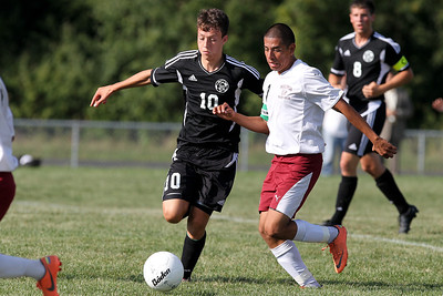 Mike Greene - mgreene@shawmedia.com Kaneland's Arsim Azemi (left) and Marengo's Miguel Cortez vie for posession during a game Tuesday, August 21, 2012 at Marengo High School. Kaneland defeated Marengo 4-1.
