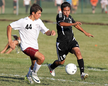 Mike Greene - mgreene@shawmedia.com Marengo's Robert Proffitt (left) and Kaneland's Arsim Azemi vie for possession during a game Tuesday, August 21, 2012 at Marengo High School. Kaneland defeated Marengo 4-1.