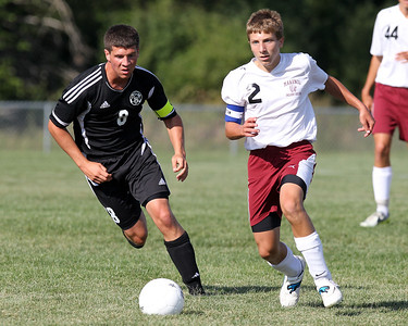 Mike Greene - mgreene@shawmedia.com Kaneland's Alex Gil (left) chases after Marengo's Jake Piske during a game Tuesday, August 21, 2012 at Marengo High School. Kaneland defeated Marengo 4-1.