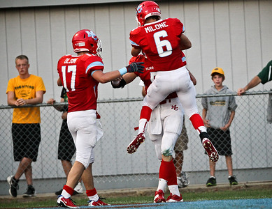 Josh Peckler - Jpeckler@shawmedia.com Marian Central's Brett Olsen (17) and Tony Milone (6) congratulate Chris Streveler after he ran the ball to the one yard line during the first quarter against Crystal Lake South at Marian Central Catholic High School Friday, August 24, 2012.