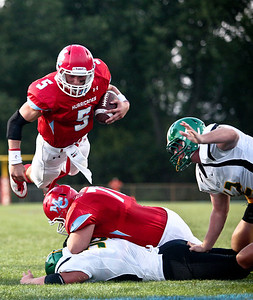 Josh Peckler - Jpeckler@shawmedia.com Marian Central quarterback Chris Streveler (5) dives over a pile to reach the end zone during the first quarter against Crystal Lake South at Marian Central Catholic High School Friday, August 24, 2012.