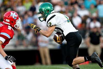 Josh Peckler - Jpeckler@shawmedia.com Crystal Lake South's Lake Larson prepares to stiff arm Marian Central's Tyler Hickey during the second quarter at Marian Central Catholic High School Friday, August 24, 2012.