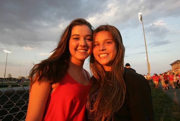 H. Rick Bamman - hbamman@shawmedia.com<br /> Rosary high school students Claire Knoebel (left) and Maddie Deufel wait for the Marmion Jacobs football game to begin.