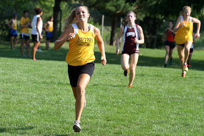Mike Greene - mgreene@shawmedia.com Jacobs' Sam Baran kicks towards the finish line of the girls 3 mile competition during a McHenry County Cross Country Meet Saturday, August 25, 2012 at McHenry Township Park in Johnsburg.