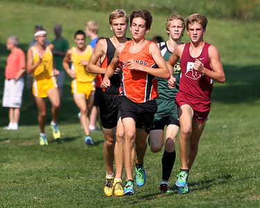 Mike Greene - mgreene@shawmedia.com McHenry's Jesse Reiser (left) and Prairie Ridge's Joe Cowlin lead the way in the boys 3 mile competition during a McHenry County Cross Country Meet Saturday, August 25, 2012 at McHenry Township Park in Johnsburg.