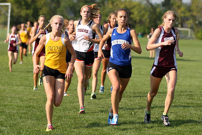 Mike Greene - mgreene@shawmedia.com Jacobs' Lauren Van Vlierbergen (left), Woodstock's Maura Beattie (center) and Marengo's Katie Adams lead the pack during a McHenry County Cross Country Meet Saturday, August 25, 2012 at McHenry Township Park in Johnsburg.