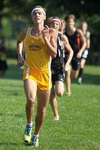 Mike Greene - mgreene@shawmedia.com Jacobs' Ryan Ross runs towards the finish line of the boys 3 mile competition during a McHenry County Cross Country Meet Saturday, August 25, 2012 at McHenry Township Park in Johnsburg.