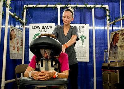 Josh Peckler - Jpeckler@shawmedia.com Megan Norton with the Strelcheck Chiropractic Clinic massages the back of Estella Patton of Woodstock inside one of the exhibitor booths during the McHenry County Fair Wednesday, August 1, 2012.