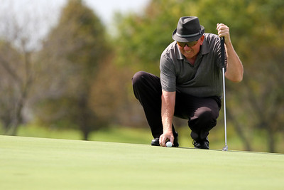Mike Greene - mgreene@shawmedia.com Fred Miller lines up his putt on the 2nd hole during the first day of the the McHenry County Senior Amateur tournament Wednesday, August 15, 2012 at Whisper Creek Golf Club in Huntley.