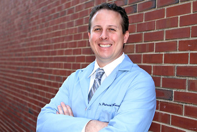 Mike Greene - mgreene@shawmedia.com Dr. Patrick McEneaney, a podiatric surgeon at Cary-Grove Foot and Ankle Center, poses Thursday, September 6, 2012 outside his office in Cary. McEneaney, who dedicats his free time to helping local athletes to train effecitively and avoid injury, is one of the Business Journal's Best Under 40 for 2012.