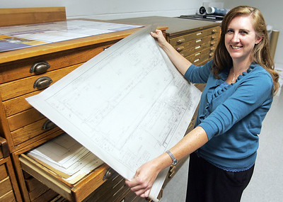 H. Rick Bamman -hbamman@shawmedia.com Carolyn Grieves in the file room of Baxter and Woodman Consulting Engineers. Grieves is the manager of water department. Grieves is one of the Business Journal's Best Under 40 for 2012.
