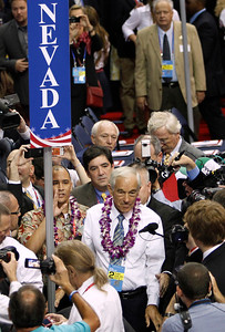 Rep. Ron Paul, R-Texas, makes his way through the convention floor as he arrives for the Republican National Convention in Tampa, Fla., on Tuesday, Aug. 28, 2012. (AP Photo/Lynne Sladky)