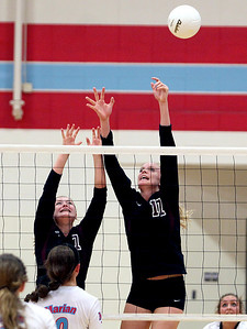 Sarah Nader - snader@shawmedia.com Richmond-Burton's Kelsey Burlini (left) and Ali Frantti jump to block a shot by Marian Central during Tuesday's game in Woodstock on August 28, 2012. Richmond-Burton won, 2-0.