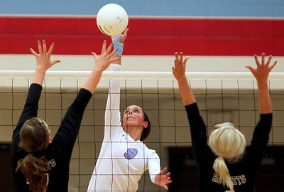Sarah Nader - snader@shawmedia.com Marian Central's Meredith Patterson (center) jumps to block the shot during Tuesday's game against Richmond-Burton in Woodstock on August 28, 2012. Richmond-Burton won, 2-0.