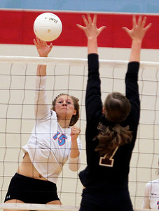 Sarah Nader - snader@shawmedia.com Marian Central's Shannon Wuensch jumps to block a shot during Tuesday's game against Richmond-Burton on August 28, 2012 in Woodstock. Richmond-Burton won, 2-0.