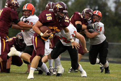 Mike Greene - mgreene@shawmedia.com Richmond-Burton quarterback Matthew Malecki runs past the line during a sneak in the first quarter of a non-conference game against Winnebago Friday, August 31, 2012 in Richmond. Winnebago defeated Richmond-Burton 44-28.
