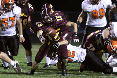 Mike Greene - mgreene@shawmedia.com Richmond-Burton running back Sean Kirby reaches for a ball after fumbling during the second quarter of a non-conference game against Winnebago Friday, August 31, 2012 in Richmond. Winnebago defeated Richmond-Burton 44-28.