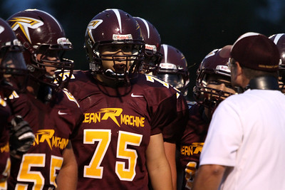 Mike Greene - mgreene@shawmedia.com Richmond-Burton lineman Vincent Battaglia and teammates listen to head coach Patrick Elder during the second quarter of a non-conference game against Winnebago Friday, August 31, 2012 in Richmond. Winnebago defeated Richmond-Burton 44-28.