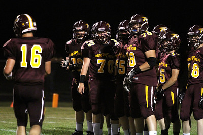 Mike Greene - mgreene@shawmedia.com Richmond-Burton lineman wait for quarterback Matthew Malecki to come back to the huddle with a play before the end of the second quarter of a non-conference game against Winnebago Friday, August 31, 2012 in Richmond. Winnebago defeated Richmond-Burton 44-28.
