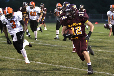 Mike Greene - mgreene@shawmedia.com Richmond-Burton running back Christopher Vlasak outruns defenders en-route to a 69-yard touchdown run during the second quarter of a non-conference game against Winnebago Friday, August 31, 2012 in Richmond. Winnebago defeated Richmond-Burton 44-28.