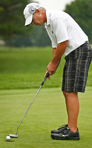 Bret Moist / For the Northwest Herald David Missimer putts his ball during the final day of the McHenry County Senior Amateur tournament at the Pinecrest Golf and Country Club in Huntley on Thursday. David would finish the tournament in 3rd place with a score of 160.