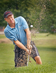 Brett Moist / For the Northwest Herald Gene Beck hits out of the sand trap during the final day of the McHenry County Senior Amateur tournament at the Pinecrest Golf and Country Club in Huntley on Thursday. Gene won the Senior 1st flight division with a score of 156.