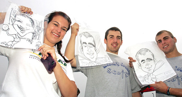 H. Rick Bamman - hbamman@shawmedia.com McHenry Couny College students from left, Kate Harney of Wilmette, Matt Schmidt of West Dundee and Nick Kostalek of Huntley show off their caricature art drawn by artist Kevin Berg at the MCC New-Student Convocation.