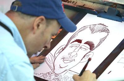 H. Rick Bamman - hbamman@shawmedia.com Caricature artist Kevin Berg draws a likeness of MCC student Matt Schmidt of West Dundee.