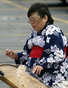 H. Rick Bamman - hbamman@shawmedia.com Mariko Hosokawa performed on a traditional Japaneese Koto.