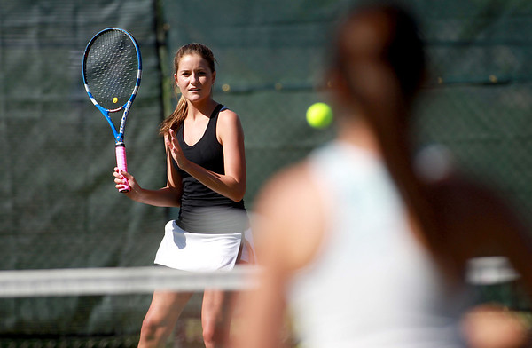 Sandy Bressner - sbressner@shawmedia.com<br /> Geneva senior Kelsey Hess returns the ball to her sister and doubles partner, Margo, during practice Wednesday afternoon.