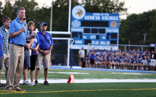 Jeff Krage – For the Kane County Chronicle<br /> Geneva High School principal Tom Rogers address the crowd during Wednesday's dedication ceremony for the new turf on Burgess Field.<br /> Geneva 8/22/12