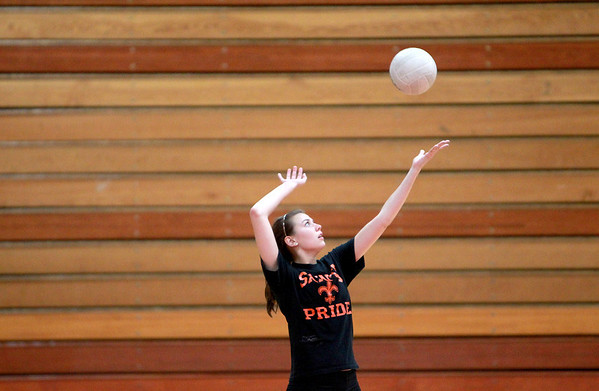 Sandy Bressner - sbressner@shawmedia.com<br /> St. Charles East senior Nicole Woods serves the ball during practice Monday afternoon.