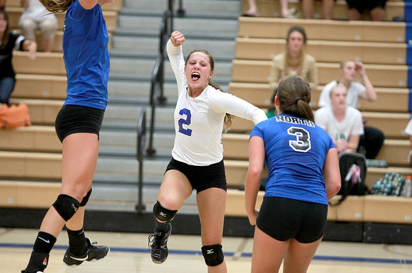 Sandy Bressner - sbressner@shawmedia.com<br /> St. Charles North's Taylor Krage (far left), Alex Busch (center) and Emily Belz (3) celebrate a point during their 19-25, 25-17, 25-23 win  over York Tuesday night at home.