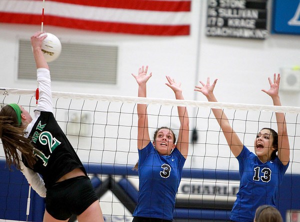 Sandy Bressner - sbressner@shawmedia.com<br /> St. Charles North's Emily Belz (#3) and Sophia DuVall (13) try to block a kill from York's Melissa Deatsch (12) during North's 19-25, 25-17, 25-23 win Tuesday night at home.