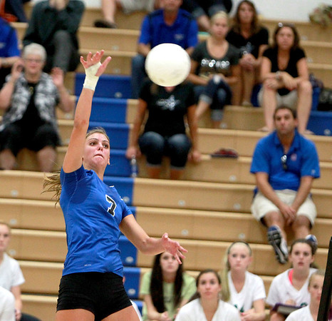 Sandy Bressner - sbressner@shawmedia.com<br /> St. Charles North's Taylor Krage gets the ball over the net during their 19-25, 25-17, 25-23 win  over York Tuesday night at home.