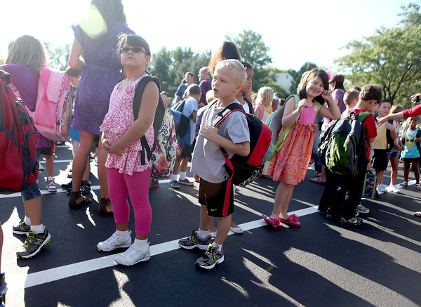 Sandy Bressner - sbressner@shawmedia.com<br /> Students arrive for their first day of school at Fox Ridge Elementary School in St. Charles Wednesday morning.