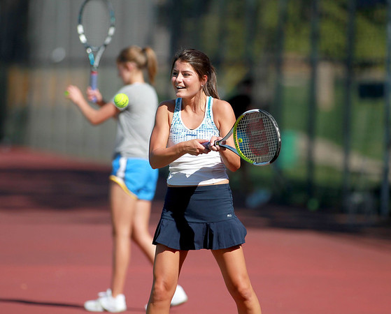 Sandy Bressner - sbressner@shawmedia.com<br /> Geneva junior Margo Hess returns the ball to her sister and doubles partner, Kelsey, (not pictured) during practice Wednesday afternoon.