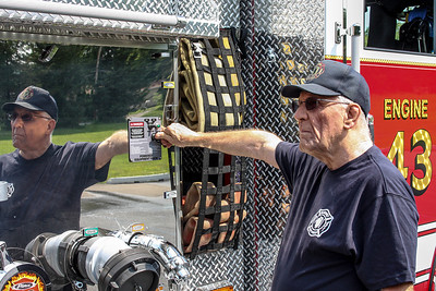 Jim Dallke - jdallke@shawmedia.com Al Robel trains on the new fire engine at the McHenry Township Fire Department station 2 Friday, August 2, 2013. Robel retired on Friday after 36 years at the department.