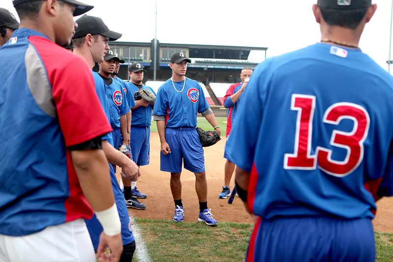 Albert Almora, a first-round draft pick for the Chicago Cubs and an outfielder for Cubs Class A affiliate Kane County Cougars, warms up with his teammates before a game at Fifth Third Bank Ballpark in Geneva.