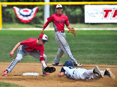 Josh Peckler - For Northwest Herald Mac N Seitz Royals' Willis Wiedeman (left) tries to tag out Illinois Elite's Nick Price during the first inning of the Championship game for the MCYSA 15U International Championships at Lippold Park in Crystal Lake Sunday, August 4, 2013.
