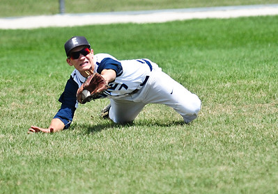 Josh Peckler - For Northwest Herald Illinois Elite's Dan Minik lays out for a ball during the third inning of the Championship game for the MCYSA 15U International Championships against the Mac N Seitz Royals at Lippold Park in Crystal Lake Sunday, August 4, 2013.