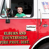 Brody Snow, 2, of Elburn sits in the driver's seat of a Elburn and Countryside tender truck during Elburn's National Night Out event at Lions Park Tuesday.