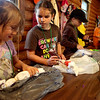 (Left to right)Sabrina Scransky, 6, Abby Reilley, 8, and Brigid Gannon, 8, make tie-dyed pillowcases during the Girl Scout Trefoil Service Unit 407 Camp-Cation at Camp Dean in Big Rock Monday. The service unit includes Girl Scouts from Sugar Grove and Elburn.