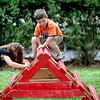 Aubrey Nystrom, 5, and Luke Pawlak, 5, both of Elburn, climb a ladder as part of a fire department obstacle course during Elburn's National Night Out event at Lions Park Tuesday.