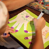 Emilee Schultz, 7, makes a craft using cut-outs of a hand as part of the Kindness Campaign, which has partnered with Girl Scout Trefoil Service Unit 407 for their Camp-Cation at Camp Dean in Big Rock Monday. The service unit includes Girl Scouts from Sugar Grove and Elburn.