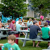 Residents enjoy their refreshments during Elburn's National Night Out event at Lions Park Tuesday.