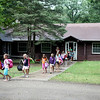 Members of Girl Scout Trefoil Service Unit 407 leave for their next activity during their Camp-Cation at Camp Dean in Big Rock Monday. The service unit includes Girl Scouts from Sugar Grove and Elburn.